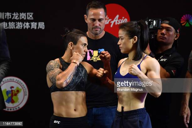 Opponents Jessica Andrade of Brazil and Zhang Weili of China face off during the UFC Fight Night weighins at the Futian ShangriLa on August 30 2019...