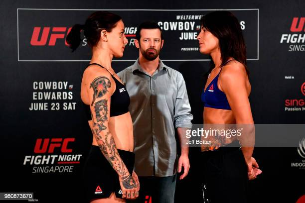 Opponents JessicaRose Clark of Australia and Jessica Eye face off during the UFC Fight Night weighin at the Mandarin Oriental on June 22 2018 in...