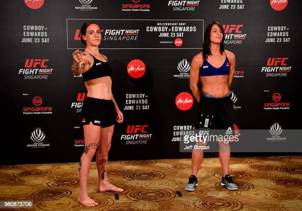Opponents JessicaRose Clark of Australia and Jessica Eye pose for the media during the UFC Fight Night weighin at the Mandarin Oriental on June 22...