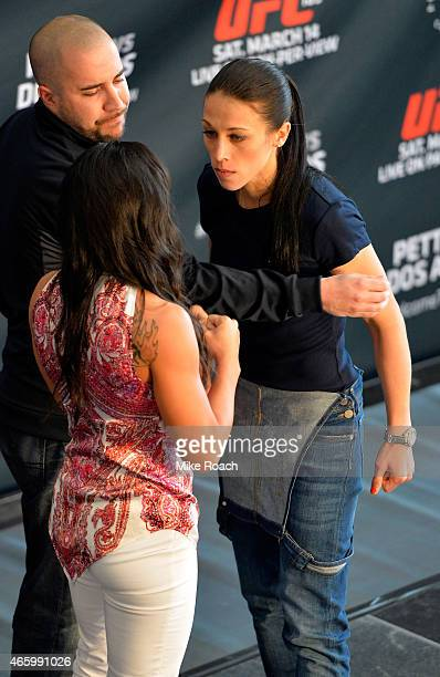 Opponents Joanna Jedrzejczyk of Poland and Carla Esparza face off during the UFC 185 Ultimate Media Day at the American Airlines Center on March 12...
