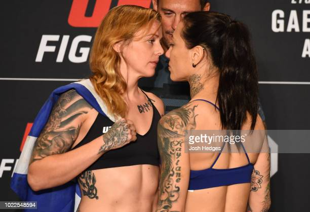 Opponents Joanne Calderwood of Scotland and Kalindra Faria of Brazil face off during the UFC weighin on August 24 2018 in Lincoln Nebraska
