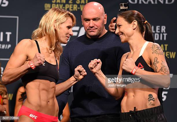 Opponents Justine Kish and Nina Ansaroff face off during the UFC 195 weighin at the MGM Grand Conference Center on January 1 2016 in Las Vegas Nevada