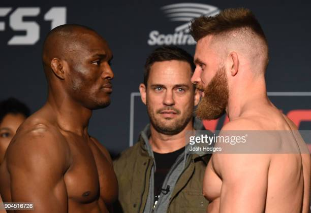 Opponents Kamaru Usman of Nigeria and Emil Meek of Norway face off during the UFC Fight Night weighin on January 13 2018 in St Louis Missouri