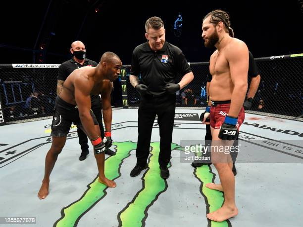 Opponents Kamaru Usman of Nigeria and Jorge Masvidal face off prior to their UFC welterweight championship fight during the UFC 251 event at Flash...