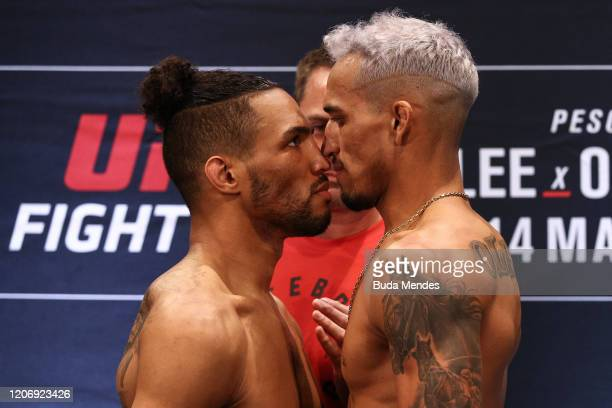 Opponents Kevin Lee of the United States and Charles Oliveira of Brazil face off during during the UFC Fight Night Lee v Oliveira weighin at Windsor...