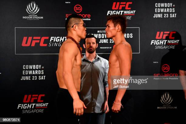 Opponents Li Jingliang of China and Daichi Abe of Japan face off during the UFC Fight Night weighin at the Mandarin Oriental on June 22 2018 in...