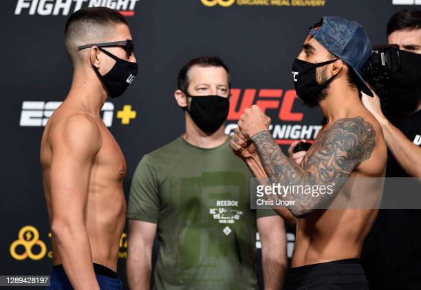 Opponents Louis Smolka and Jose Quinonez of Mexico face off during the UFC Fight Night weigh-in at UFC APEX on December 04, 2020 in Las Vegas, Nevada.