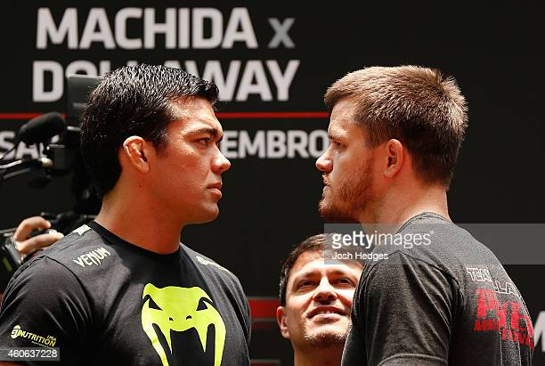 Opponents Lyoto Machida of Brazil and CB Dollaway of the United States face off during an open training session for fans and media at Allianz Parque...