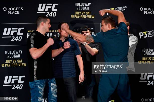 Opponents MarcAndre Barriault of Canada and Krzysztof Jotko of Poland face off for media during the UFC 240 Ultimate Media Day at Delta Hotels by...