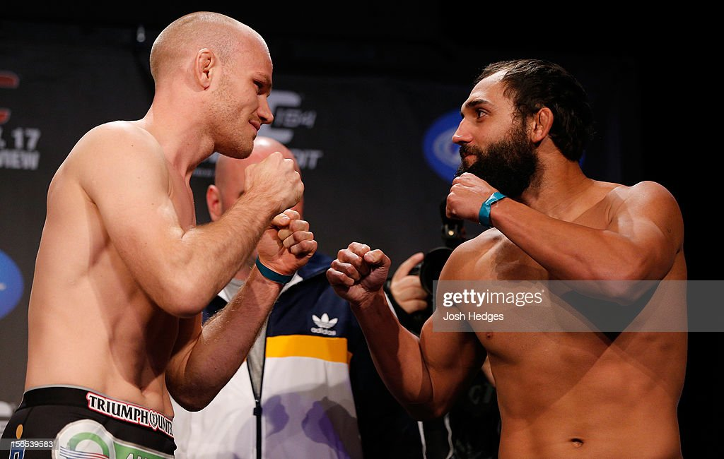Opponents Martin Kampmann and Johny Hendricks face off during the official UFC 154 weigh in at New City Gas on November 16, 2012 in Montreal, Quebec, Canada.