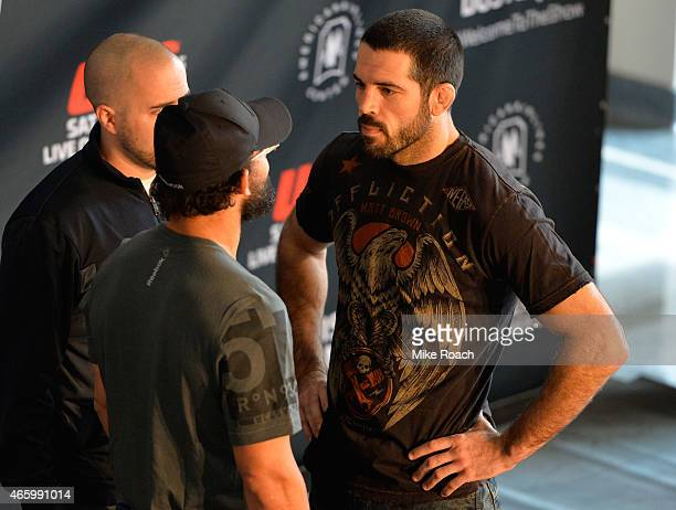 Opponents Matt Brown and Johny Hendricks face off during the UFC 185 Ultimate Media Day at the American Airlines Center on March 12 2015 in Dallas...