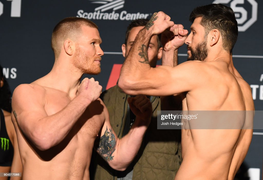 Opponents Matt Frevola and Marco Polo Reyes of Mexico face off during the UFC Fight Night weigh-in on January 13, 2018 in St. Louis, Missouri.
