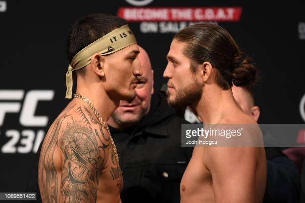 Opponents Max Holloway and Brian Ortega face-off during the UFC 231 weigh-in at Scotiabank Arena on December 7, 2018 in Toronto, Canada.