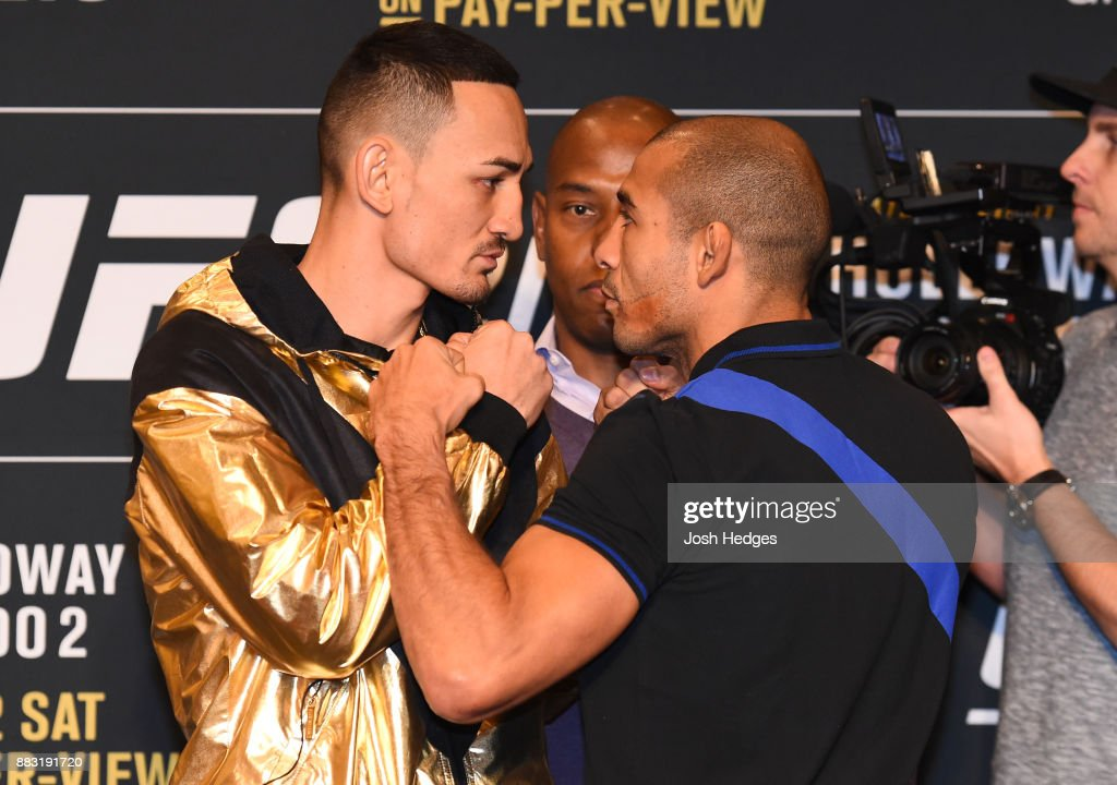 Opponents Max Holloway and Jose Aldo of Brazil face off during the UFC 218 Ultimate Media Day at the DoubleTree Hotel on November 30, 2017 in Detroit, Michigan.