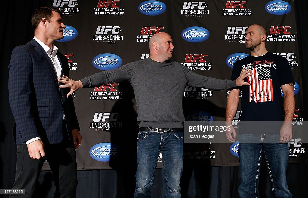 Opponents Michael Bisping (L) and Alan Belcher (R) are separated by UFC President Dana White during UFC 159 media day at The Theater at Madison Square Garden on April 25, 2013 in New York City.