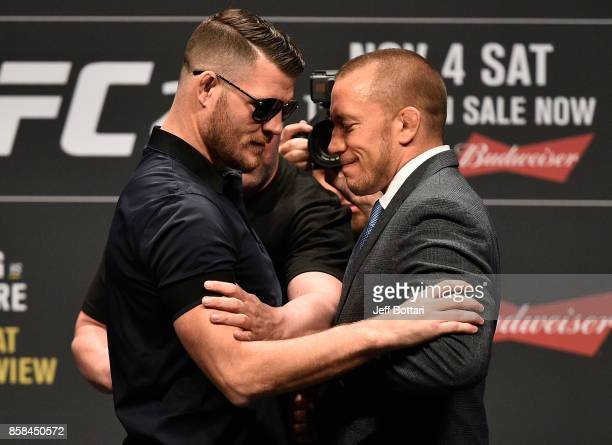 Opponents Michael Bisping and Georges StPierre face off during the UFC 217 news conference inside TMobile Arena on October 6 2017 in Las Vegas Nevada