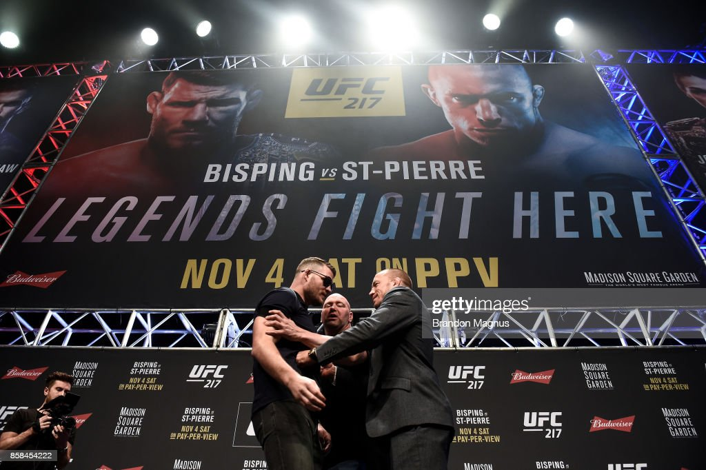 Opponents Michael Bisping and Georges St-Pierre face off during the UFC 217 news conference inside T-Mobile Arena on October 6, 2017 in Las Vegas, Nevada.