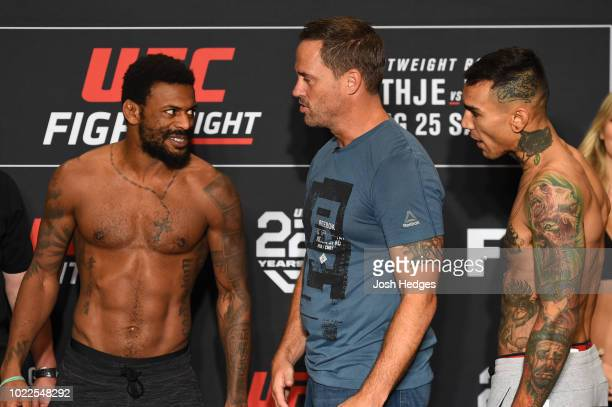 Opponents Michael Johnson and Andre Fili face off during the UFC weighin on August 24 2018 in Lincoln Nebraska