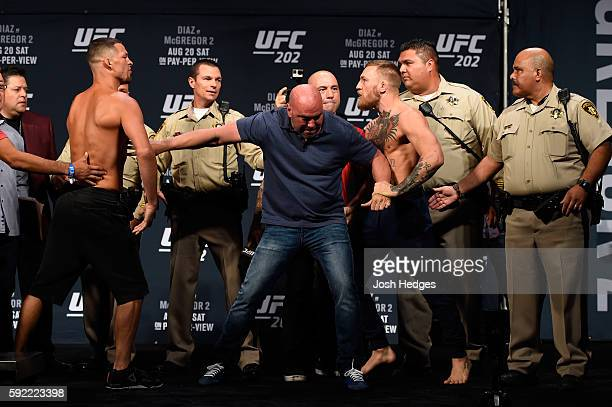 Opponents Nate Diaz and Conor McGregor of Ireland face off during the UFC 202 weighin at the MGM Grand Hotel Casino on August 19 2016 in Las Vegas...