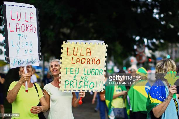Opponents of former Brazilian President Luiz Inacio Lula da Silva demonstrate in Curitiba where he is due to address a rally at the culmination of a...