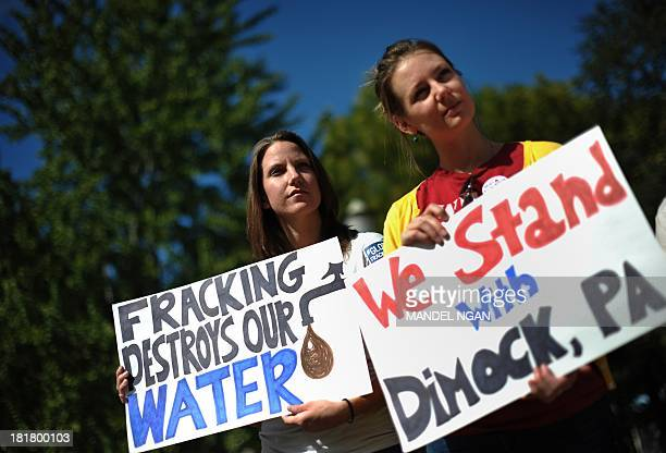 Opponents of hydraulic fracturing or 'fracking' hold placards during a rally in Lafayette Square across from the White House on September 25 2013 in...