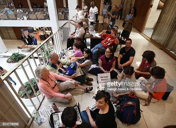 Opponents of North Carolina's HB2 sit in on the second floor of the legislative building after a rally on the Bicentennial Mall in Raleigh NC on...