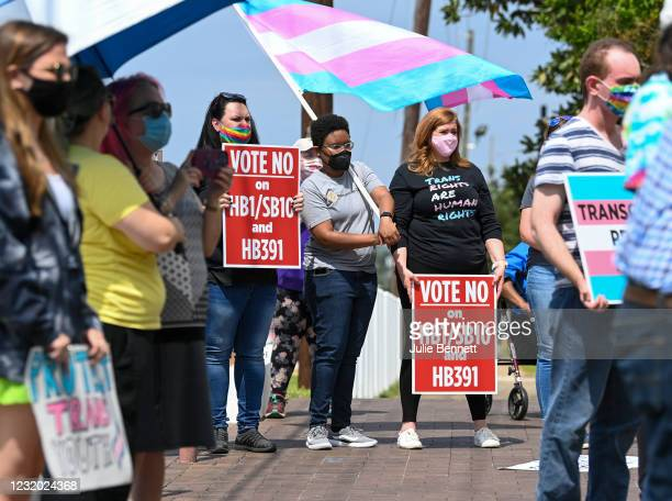 Opponents of several bills targeting transgender youth attend a rally at the Alabama State House to draw attention to anti-transgender legislation...