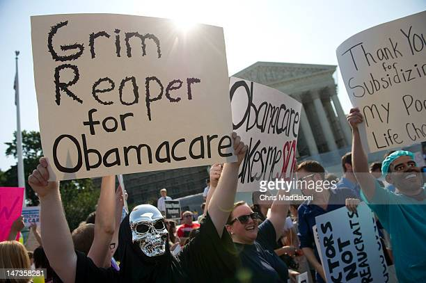 Opponents of the Affordable Care Act rally before the Supreme announces its decision about the constitutionality of the President's efforts on health...