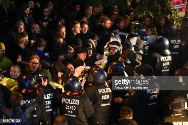 Opponents of the Alternative for Germany protest against the result of the AfD after reaching a betterthanexpected 13% and third place finish in...