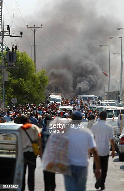 Opponents of the disengagement plan converge on burning tyres as settlers protest their evacuation from their homes August 15 2005 in the Israeli...