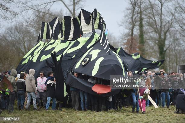 Opponents of the former NotreDamedesLandes airport project holding a giant lizard puppet parade during a rally of to celebrate the government's...