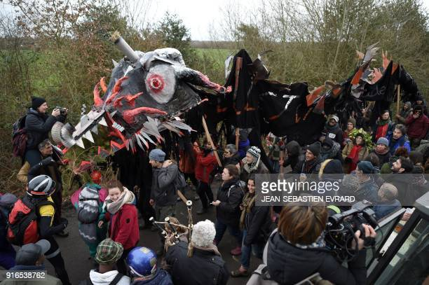 Opponents of the former NotreDamedesLandes airport project march with a dragon model during a rally to celebrate the government's decision to stop...