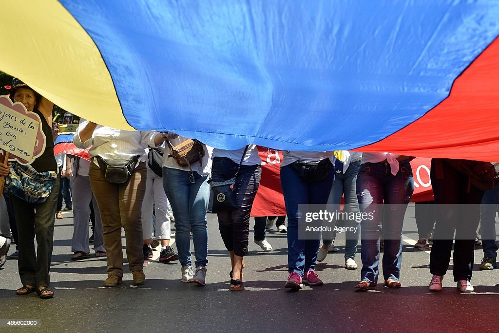 Opponents of the government of Venezuelan President Nicolas Maduro march in Caracas to mark International Women's Day on March 8, 2015.