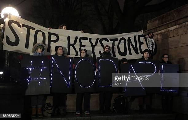 Opponents of the Keystone XL and Dakota Access pipelines hold a rally as they protest US President Donald Trump's executive orders advancing their...