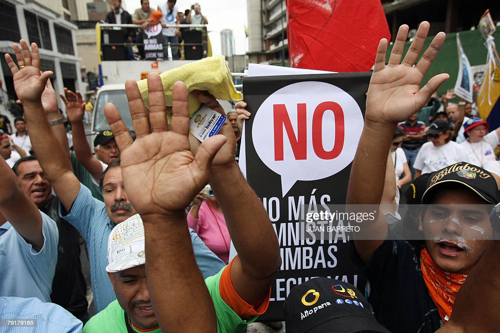 Opponents of Venezuelan president Hugo Chavez shout slogans during a demonstration 23 January, 2008 in Caracas. The Venezuelan government commemorated today the 50th anniversary of the fall of the last dictatorship -gen. Marcos P?rez Jim?nez (1948-58). AFP PHOTO/Juan BARRETO