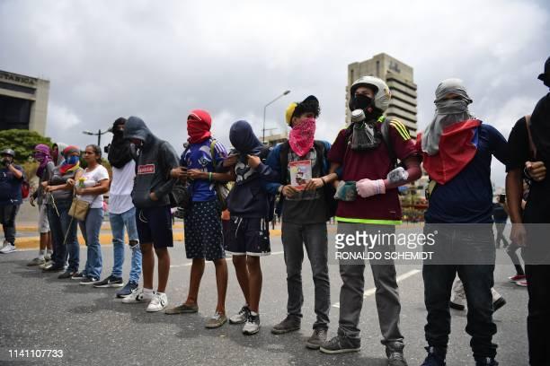 Opponents of Venezuelan President Nicolas Maduro demonstrate at El Paraiso neighborhood in Caracas on May 4 2019 Venezuelan President Nicolas Maduro...