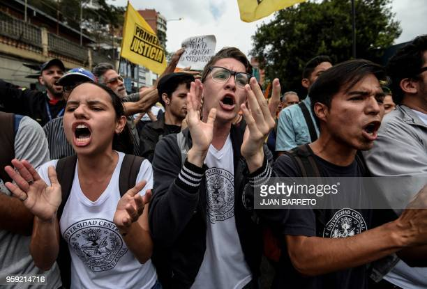 Opponents of Venezuelan President Nicolas Maduro demonstrate in front of the Organization of American States offices in Caracas on May 16 2018...