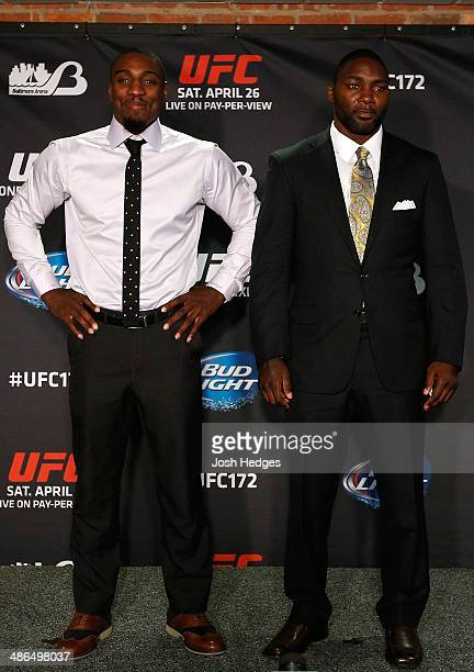 Opponents Phil Davis and Anthony Johnson pose for photos during the UFC 172 media day at Camden Yards on April 24 2014 in Baltimore Maryland