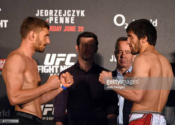Opponents Piotr Hallmann of Poland and Magomed Mustafaev of Russia face off during the UFC Berlin weighin at the O2 World on June 19 2015 in Berlin...