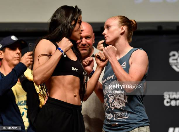 Opponents Polyana Viana of Brazil and JJ Aldrich face off during the UFC 227 weighin inside the Orpheum Theater on August 3 2018 in Los Angeles...