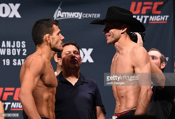 Opponents Rafael dos Anjos of Brazil and Donald 'Cowboy' Cerrone face off during the UFC weigh-in at the Orange County Convention Center on December...