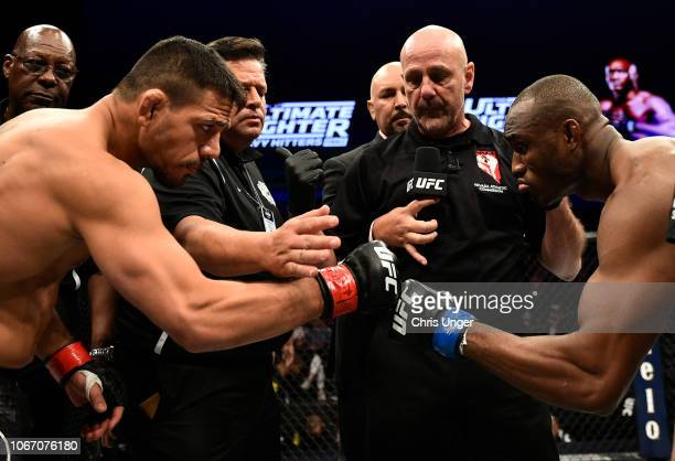 Opponents Rafael Dos Anjos of Brazil and Kamaru Usman of Nigeria face off prior to their fight during The Ultimate Fighter Finale event inside The...