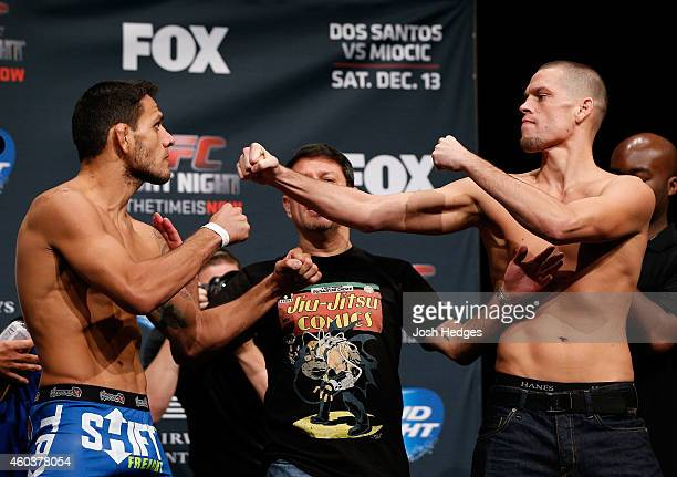 Opponents Rafael dos Anjos of Brazil and Nate Diaz face off during the UFC Fight Night weighin event at the Phoenix Convention Center on December 12...