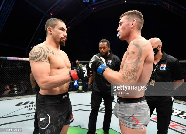 Opponents Robert Whittaker of New Zealand and Darren Till of England face off prior to their middleweight fight during the UFC Fight Night event...
