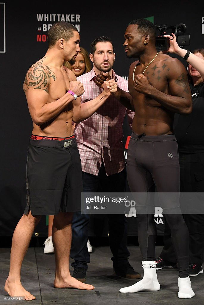 Opponents Robert Whittaker of New Zealand and Derek Brunson face off during the UFC weigh-in at Rod Laver Arena on November 26, 2016 in Melbourne, Australia.