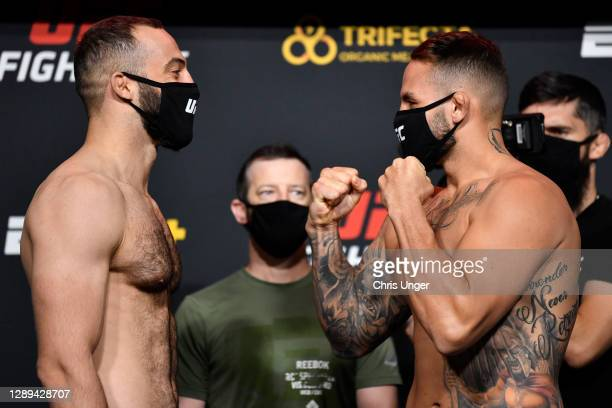 Opponents Roman Dolidze of Georgia and John Allan face off during the UFC Fight Night weigh-in at UFC APEX on December 04, 2020 in Las Vegas, Nevada.