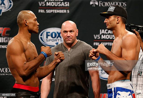 Opponents Ronaldo Jacare Souza of Brazil and Gegard Mousasi of The Netherlands face off during the UFC Fight Night weighin at Foxwoods Resort Casino...