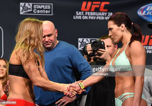 Opponents Ronda Rousey and Cat Zingano shake hands during the UFC 184 weighin at the Event Deck and LA Live on February 27 2015 in Los Angeles...