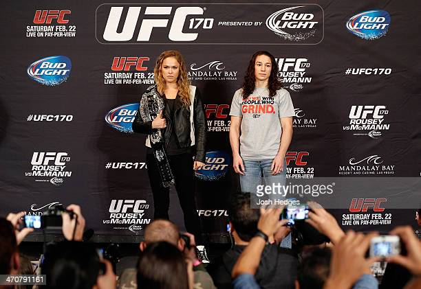 Opponents Ronda Rousey and Sara McMann pose for photos during the final UFC 170 prefight press conference at the Mandalay Bay Resort and Casino on...