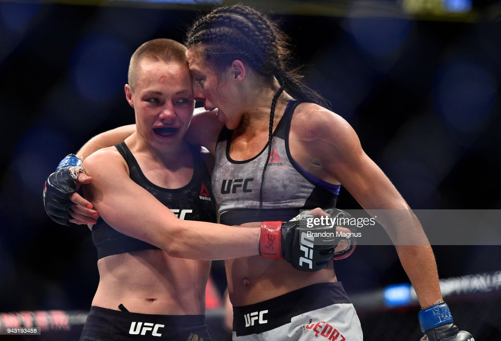 Opponents Rose Namajunas and Joanna Jedrzejczyk of Poland embraces after the conclusion of their women's strawweight title bout during the UFC 223 event inside Barclays Center on April 7, 2018 in Brooklyn, New York.